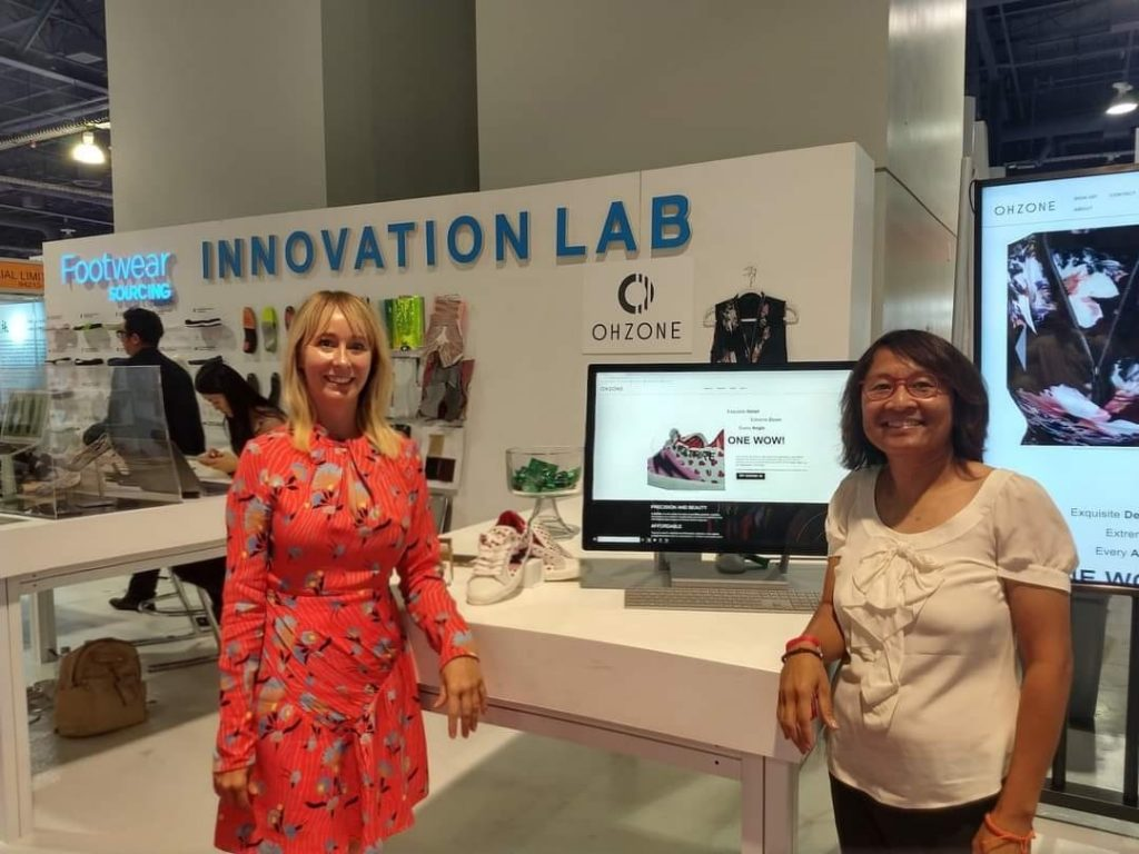 Alison Lewis and Oh Tempmonkol from OHZONE at MAGIC Las Vegas showcasing OHZONE Inc Technology